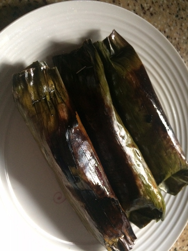 Pulut panggang wrapped in banana leaves