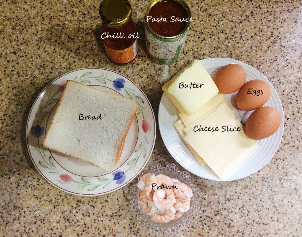 Ingredients to make homemade seafood pizza bread